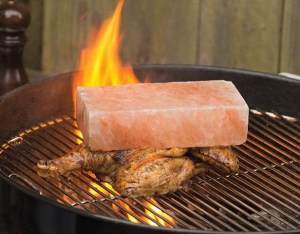 Chicken grilled beneath Himalayan Salt Brick